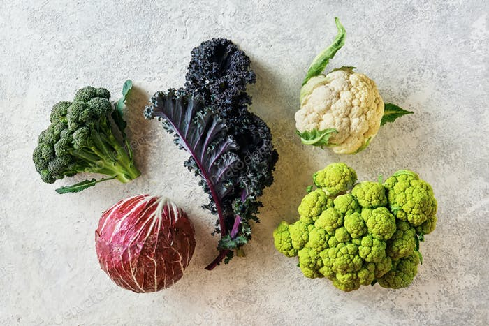 Cabbage of different varieties on a light background, cauliflower, radicchio, broccoli, Kale