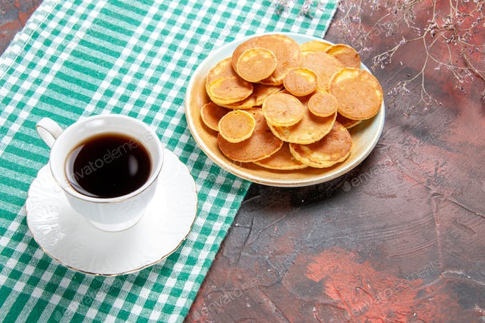 A cup of tea with pancakes horizontal images
