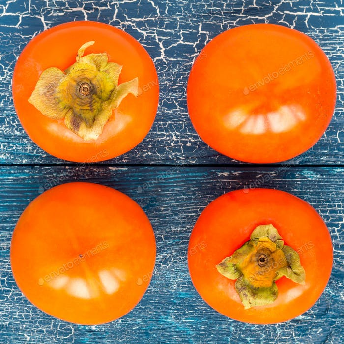 Persimmon fruits on wooden table, ready to eat, top view, square