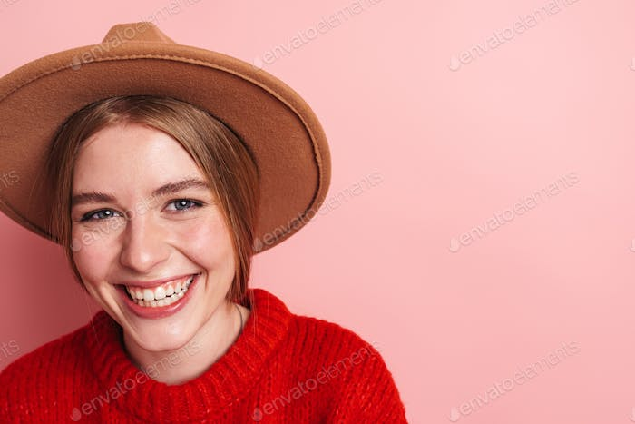 Photo of happy beautiful woman in hat laughing and looking at camera