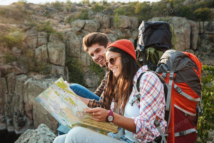 Smiling adventure couple with map