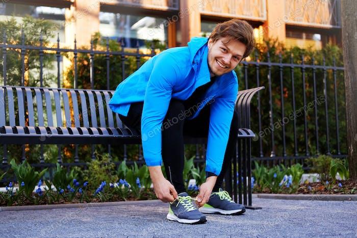 A man ties his sneakers.