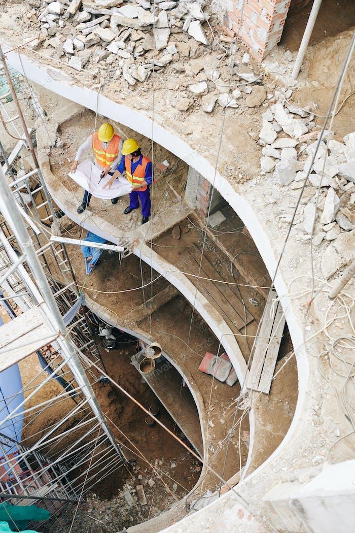 Builders discussing floor plan