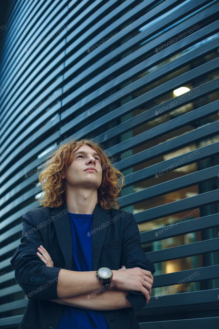 Thumbnail for Portrait of red haired man over urban futuristic background