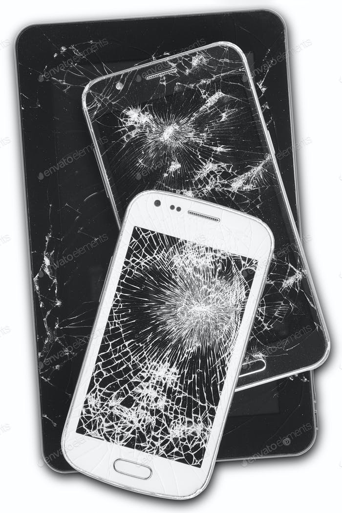 Smartphones and tablet with damaged screens isolated on white. Devices