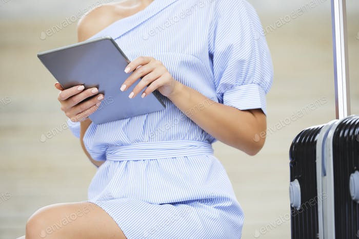 Woman reading article on tablet