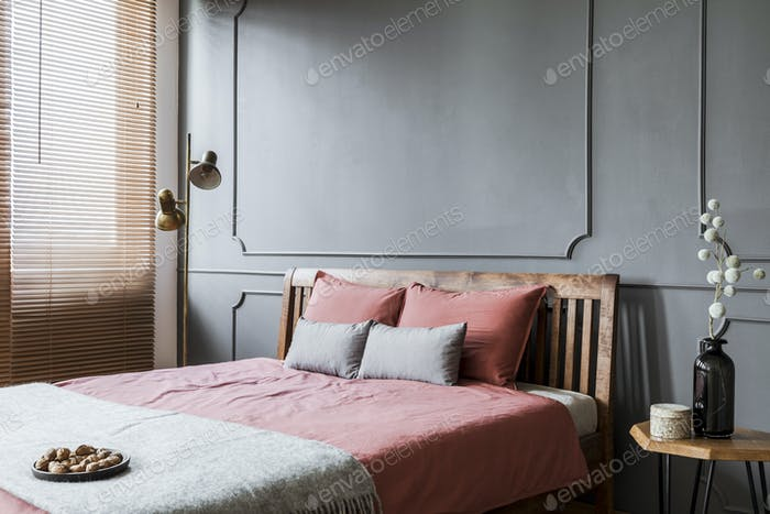 Grey and pink woman's bedroom