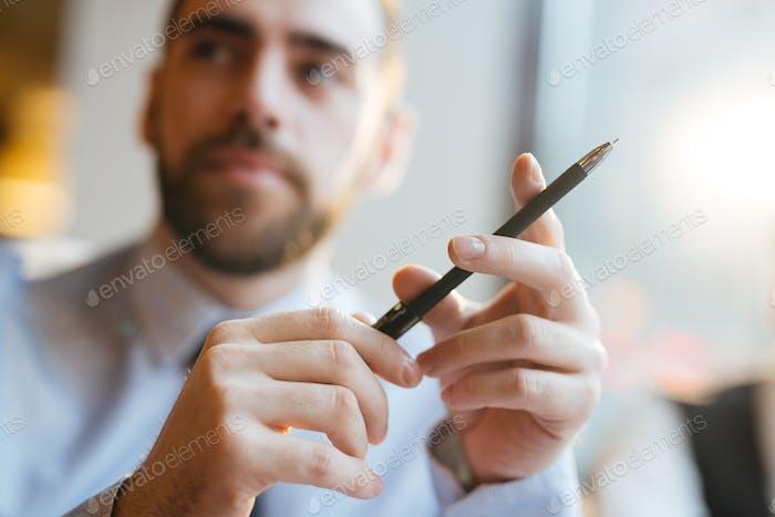 Black pen in hands
