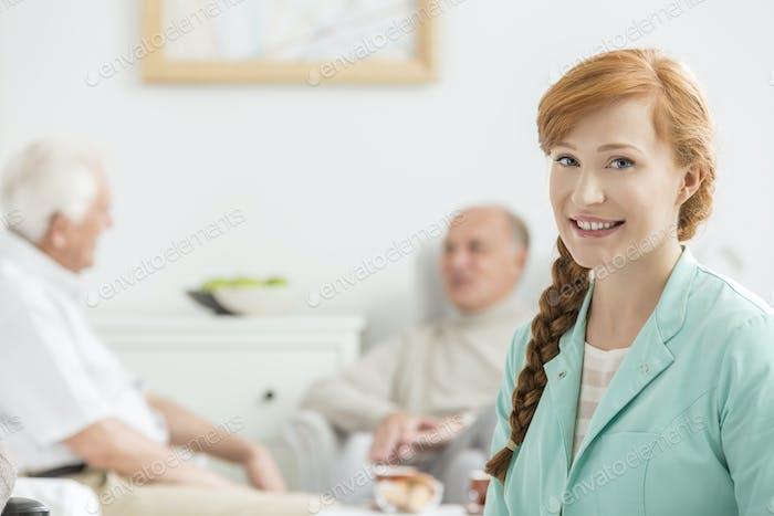 Men talking behind the nurse
