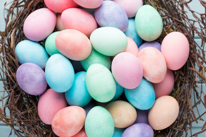 Pastel Easter eggs background. Spring greeting card.