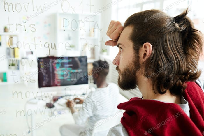 Confused coder looking at computer text
