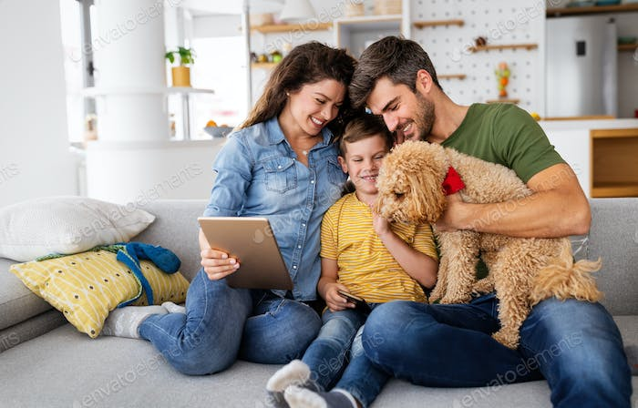 Happy modern family using computer together at home