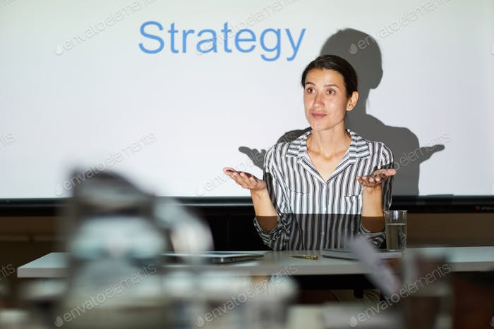 Discussing strategy for achieving goal at meeting