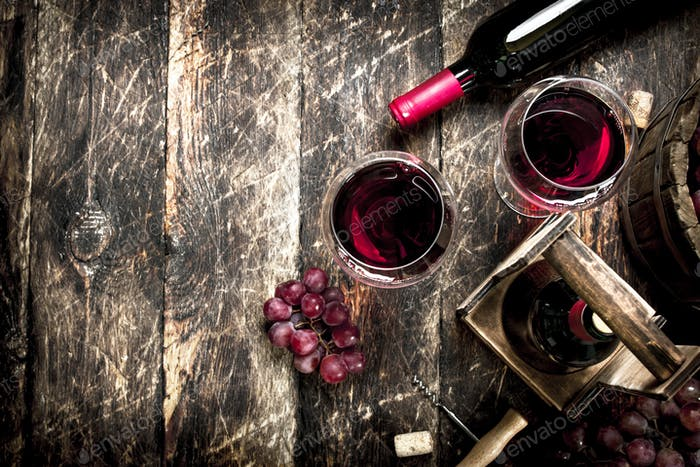 Wine background. Red wine with glasses with grapes.