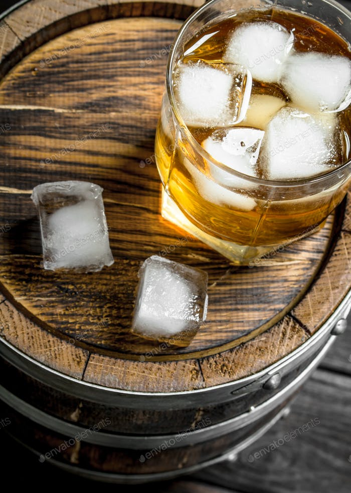 Glass of whiskey on the barrel.