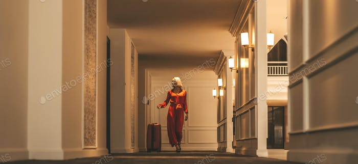 Best part of your journey. Attractive businesswoman arriving at luxury hotel.