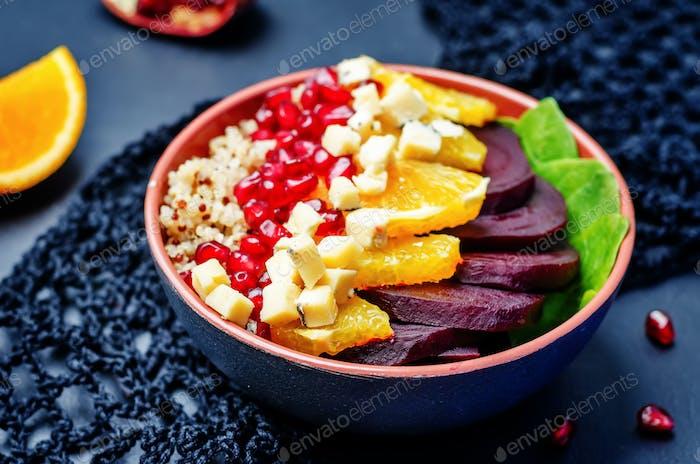 Quinoa spinach beet orange pomegranate blue cheese salad