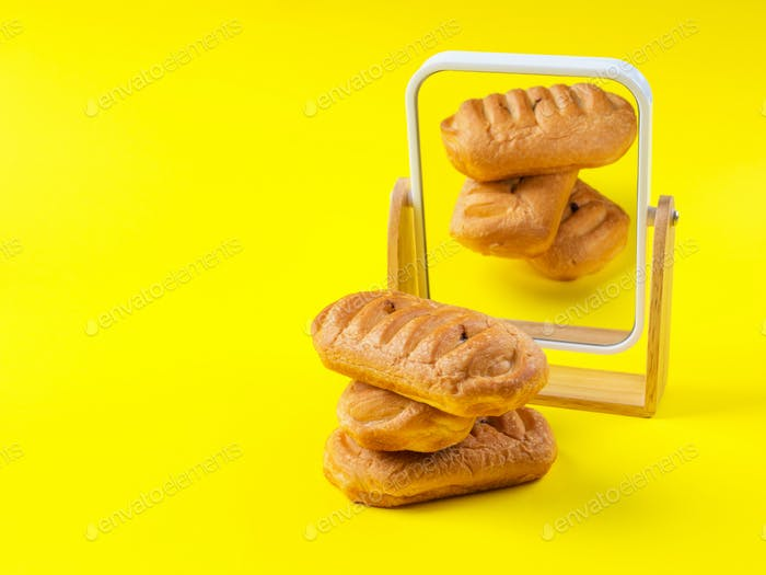 Bakery sweet pastry stack reflected in mirror