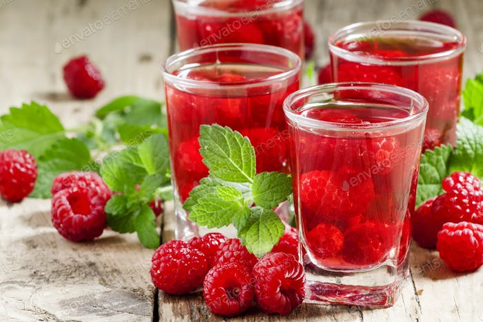 Red refreshing cocktail with raspberry and mint