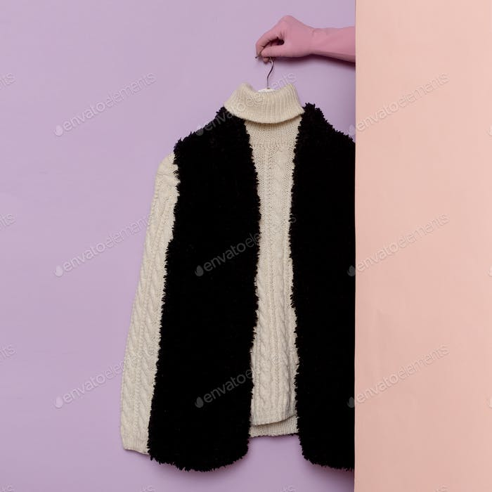 Stylish clothes. Warm sweater and fur vest. wardrobe ideas trend