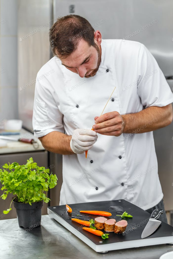 Chef preparing ornamental elements