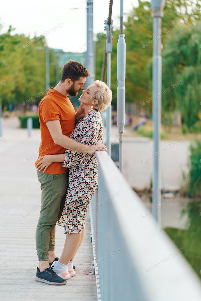 Couple kissing on the bridge