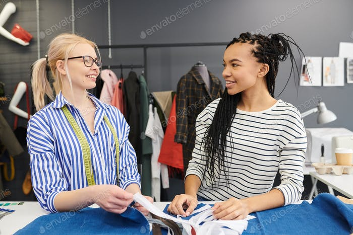 Fashion designers working over clothes collection