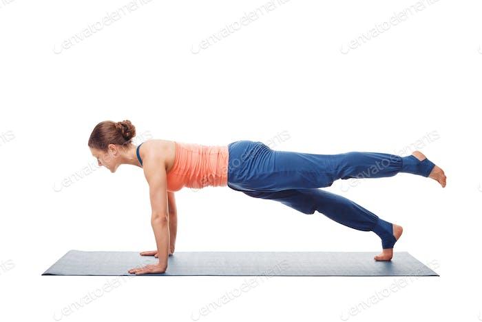 Woman doing Hatha yoga asana Utthita chaturanga dandasana