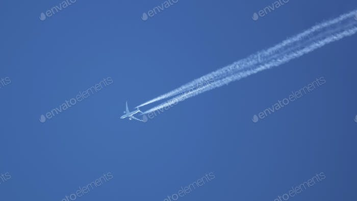 typical airplane in the blue sky