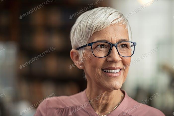 Senior woman smiling with eyeglasses