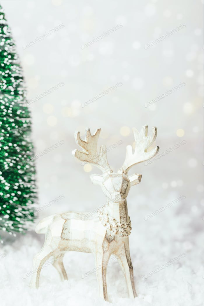 Christmas Reindeer with New Year Tree in Snowdrift.