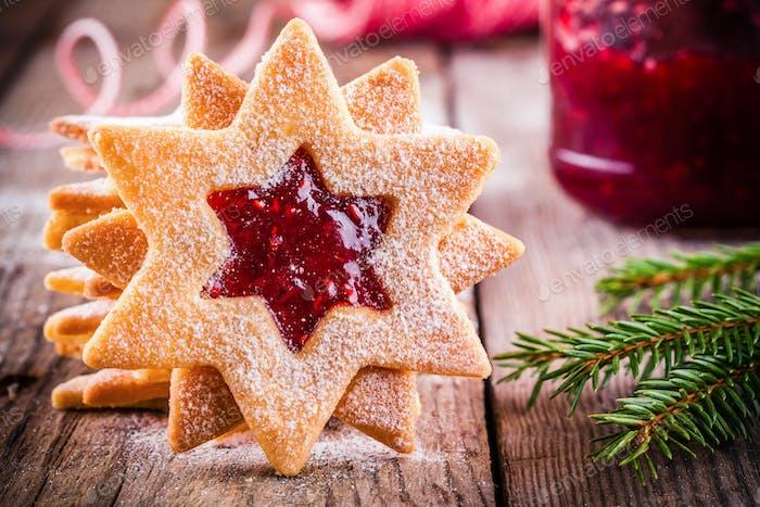 Christmas Linzer cookies with raspberry jam