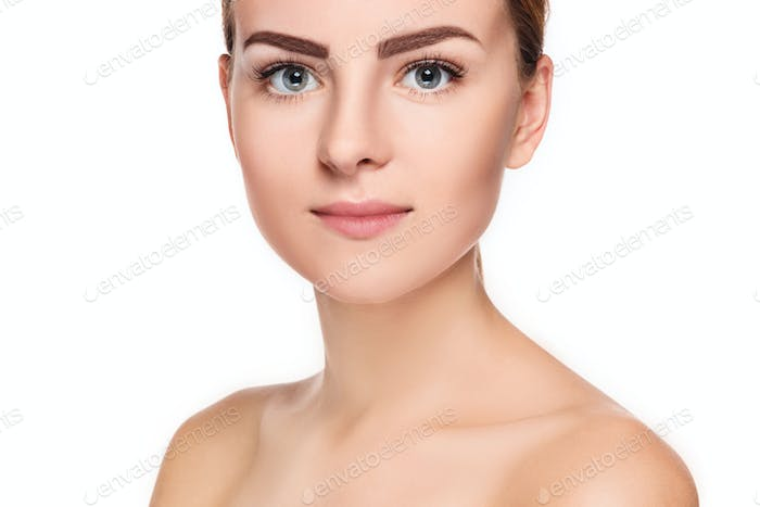 The beautiful face of young woman with cleanf fresh skin