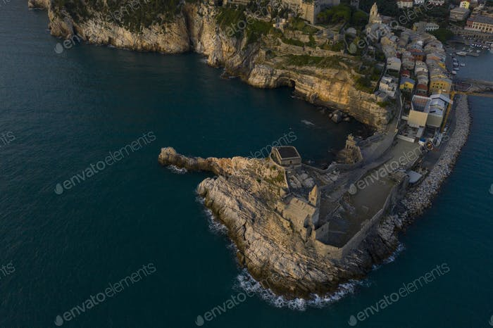 aerial shot of the church of San Pietro in Portovenere during sunset