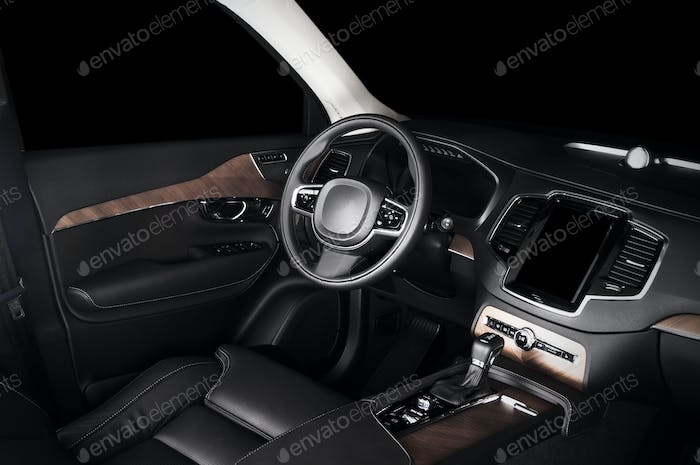 Car dashboard, modern luxury interior, steering wheel