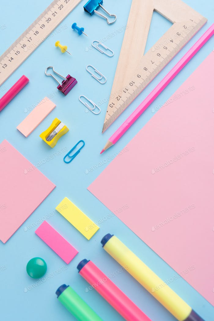 Office supplies on the blue background table