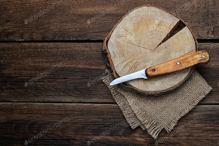 Wooden cutting board and knife.