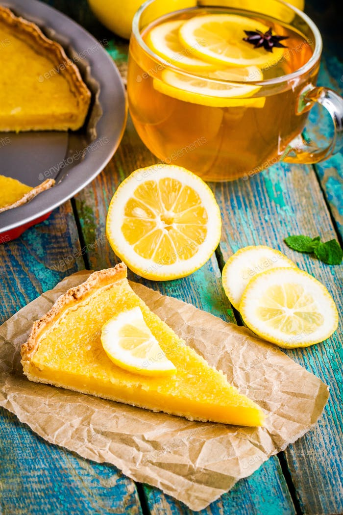 piece of lemon tart with cup of tea