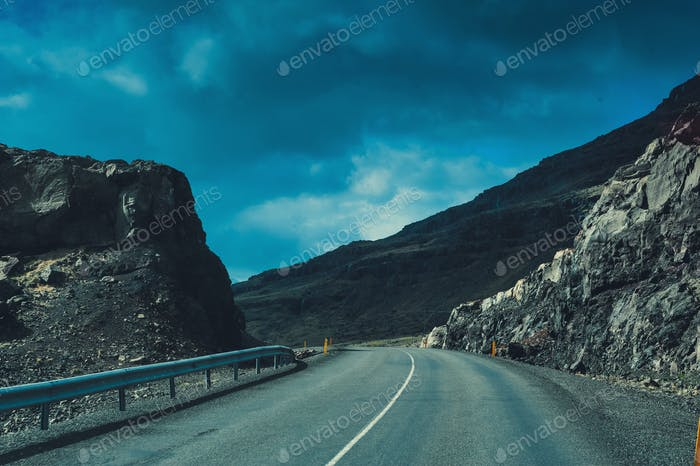 Iceland. Empty winter road highway. Mountain background view. Outdoor filming.