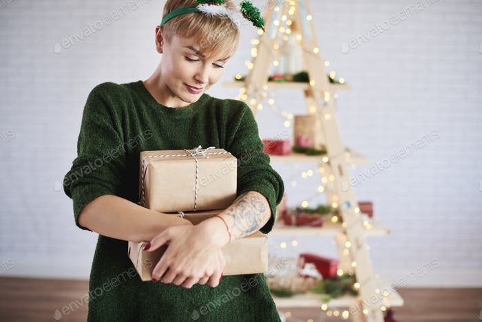 Shot of young woman holding a stack of gifts
