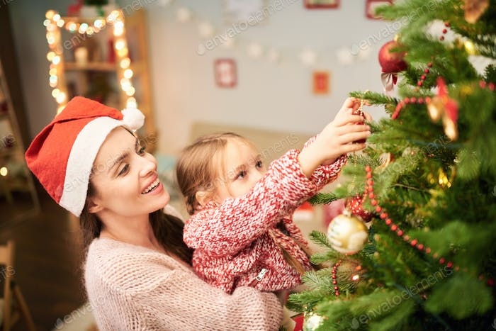 Family of Two Decorating Christmas Tree