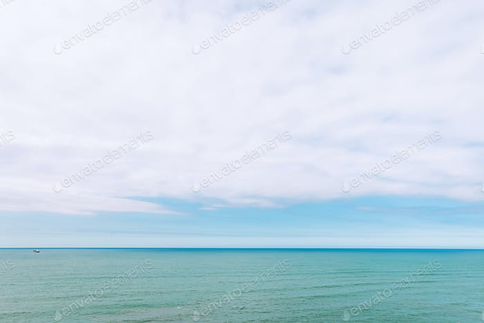 Blue sky over calm ocean