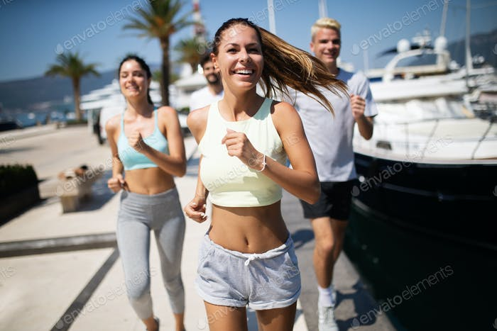 Exercising runners people training outdoors living healthy active lifestyle