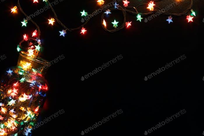 christmas lights stars border on black background