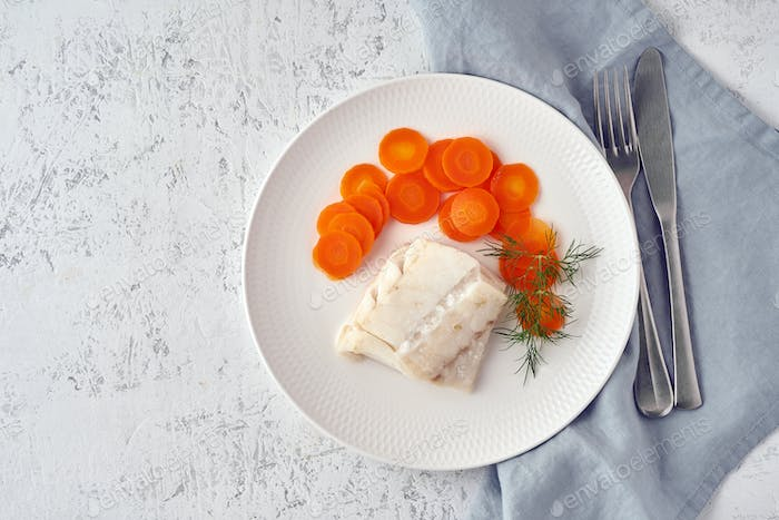 Boiled codfish with carrot and dill on white plate, fodmap dash paleo diet