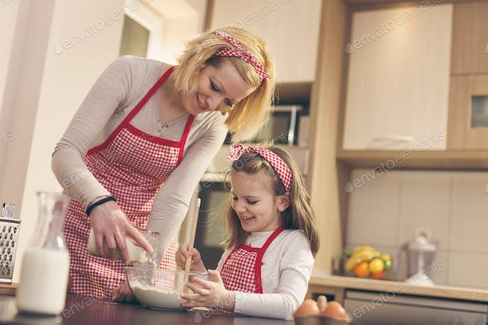Adding flour to bake a dough