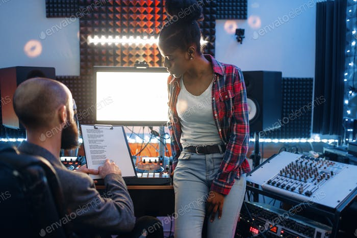Sound operator and female performer in studio