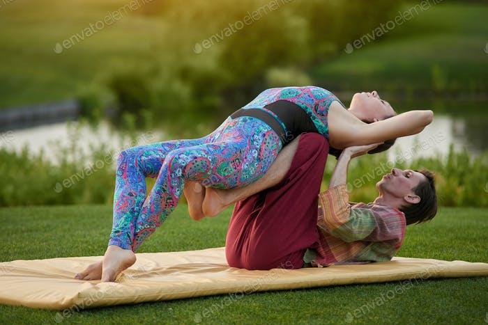 Outdoor yoga on mat.