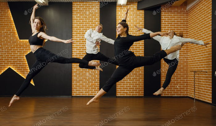 Contemporary dance studio, performers in jump