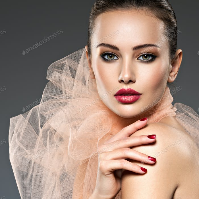 fashion woman with stylish makeup, red nails and lips wearing be
